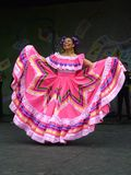Big Pink Dress. Photo of mexican woman dancer at the cinco de mayo celebration on 5/2/10 at the washington monument grounds in washington dc. Cinco de mayo