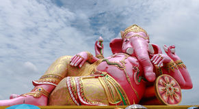 Big pink Ganesha in relaxed pose Royalty Free Stock Images