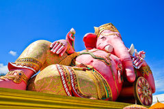 Big pink Ganesha in relaxed pose Royalty Free Stock Photo