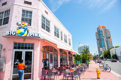 Big Pink retro era restaurant on Collins Avenue with empty table Royalty Free Stock Photos