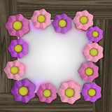 Big pink blossom square frame on wooden surface Stock Image