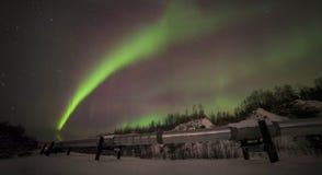 Big pipe, Aurora, night at alaska, fairbanks Royalty Free Stock Image