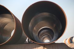Big pipe waiting for construction of a wind turbine on production site at the Maasvlakte harbor in Rotterdam, the Netherlands. Big pipe waiting for construction stock photo