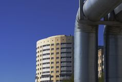 The big pipeline and building. The big pipeline on a background of the new constructed apartment house Stock Photos