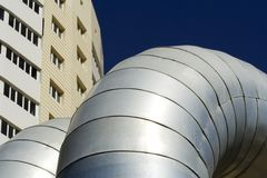 Big pipeline and new building. Royalty Free Stock Image