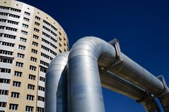 The big pipeline and new building. The big pipeline on a background of the new constructed apartment house Stock Images