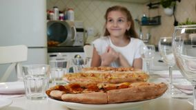 Big pizza with Cute Little Kid Girl stock video footage