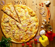 Big Pizza with vegetables herbs and olive oil Stock Photography