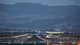 Big plane landing during the blue hour stock video footage