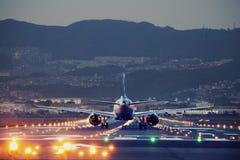 Big plane landing during blue hour stock images