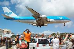 Big plane landing under heads of people Stock Image