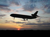 Big plane over sunset Stock Photography