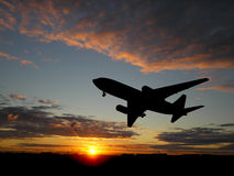 Big plane over sunset. Silhouette of airplane over sunset Stock Photography