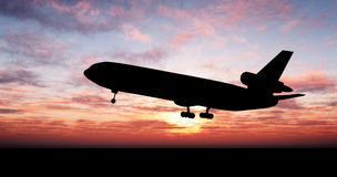 Big plane over sunset Royalty Free Stock Image