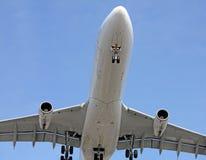 Big plane passing low Royalty Free Stock Image