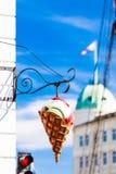 Big plastic ice cream cone sign over blue sky on city street. Big plastic ice cream cone sign over clear blue sky on city street in Denmark Royalty Free Stock Photos