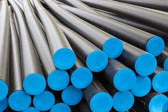 Big plastic tubes before electricty cables. Several big plastic tubes before electricty cables Stock Photo