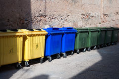 Big plastic waste containers on the street. Three type of plastic big waste cans on the street Stock Photos