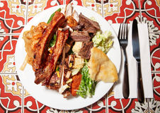 Big plate with assortment of foods Stock Photo