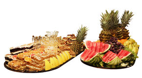 Big plate of fruits and cakes Royalty Free Stock Photography