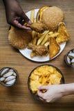 Big plate of junk food Stock Photos