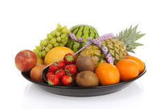Big plate with lots of healthy fruits andmeasure tape Royalty Free Stock Image