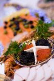Big plate with red and black caviar stock photos