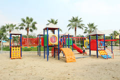 Big playground in public park and unidentified children playing it. Royalty Free Stock Image