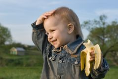 The big pleasure. Children love big exotic fruit Royalty Free Stock Photo