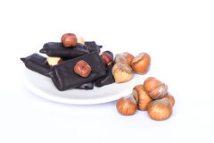 Big plum in chocolate with nuts candy royalty free stock images