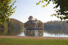 Big pond with an island, city park Tsaritsyno, season autumn.  royalty free stock photos