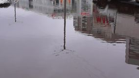 Big pool in city yard in spring. Big puddle in city yard in spring season stock video footage