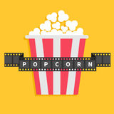 Big Popcorn. Film strip ribbon line with text. Red white box. Cinema movie night icon in flat design style. Yellow background. Royalty Free Stock Photo