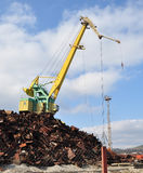 The big port crane. The crane in port loads scrap metal Stock Photography