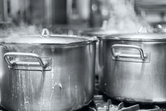 The big pot of boiling soup black and white photo Royalty Free Stock Image