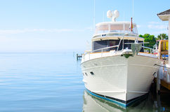 Big powerful dream yacht boat at dock Royalty Free Stock Photos