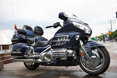 Big powerful luxury travel blue motorcycle. In parking Stock Photos