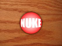 Nuclear Button on desk. Big and powerful Nuclear Button that works, on a wooden desk Stock Image