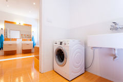 Big practical bathroom with washing machine. Big comfortable practical bathroom with washing machine at big house Royalty Free Stock Photos