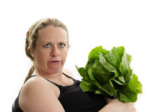 Big pregnant woman silly face vegetables Stock Images