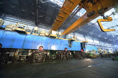 Big press machine of rolling mill. In manufacturing shop floor plant Stock Photos
