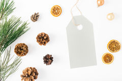 Big price tag with fir branch, cones, orange, Christmas balls Royalty Free Stock Photography