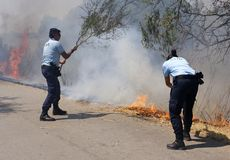 GNR police officers are fighting against the flames stock images