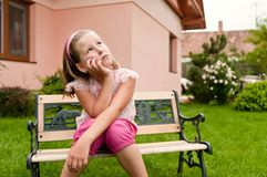 Big problems - child in garden Royalty Free Stock Images