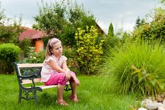 Big problems - child in garden Royalty Free Stock Photos
