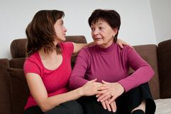 Big problems - daughter comforts senior mother Stock Photo
