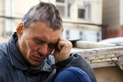 Sad homeless man in despair royalty free stock photography