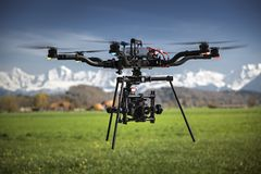 Big professional camera drone in mid-air on a film set.  royalty free stock photos