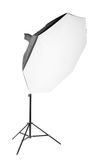 A big professional octobox, isolated on a white background. Studio equipment and lighting. The octobox with a flashlight. Stock Photo