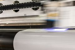 Big professional printer, processing massive vinyl rolls. royalty free stock images
